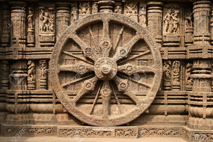 4251618-intricate-carvings-on-a-stone-wheel-in-the-ancient-surya-hindu-temple-at-konark-orissa-india-13th-ce-stock-photo